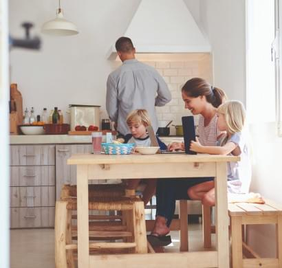 Family sitting at kitchen table | EcoWater