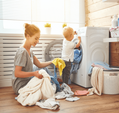 Mother and son doing laundry | EcoWater